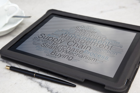 tablet with supply chain word cloud photo