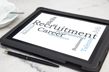 job qualifications: tablet with recruitment word cloud Stock Photo