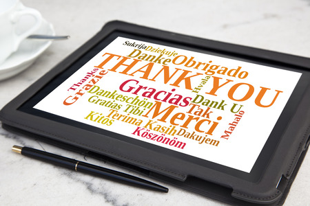 tablet with thank you word cloud Stock Photo