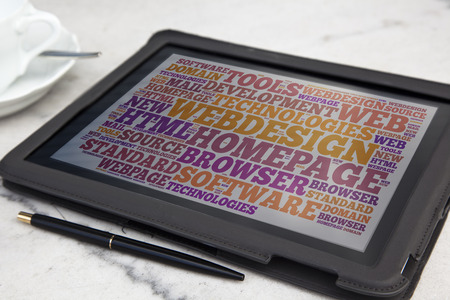 tablet with web design word cloud photo