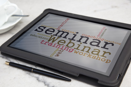 tablet with webinar word cloud Stock Photo