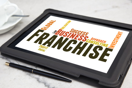 tablet with Franchise word cloud Stock Photo