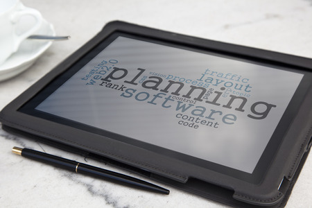 tablet with planning software word cloud photo