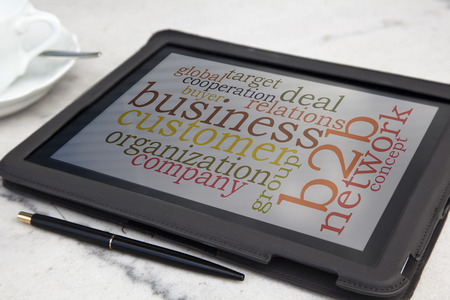 tablet with b2b word cloud photo