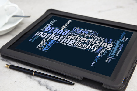 tablet with brand advertising word cloud photo