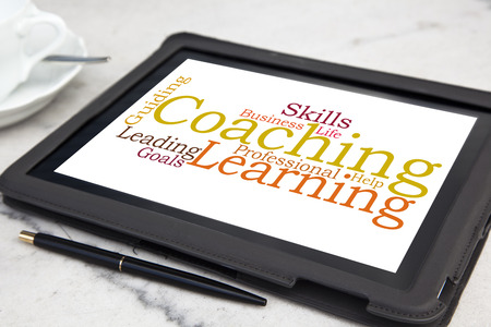tablet with personal coaching word cloud photo