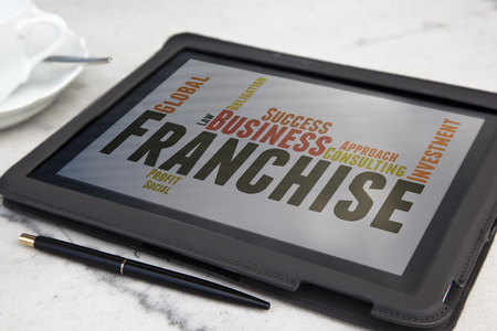 tablet with Franchise word cloud Standard-Bild