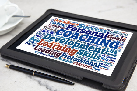 tablet with coaching word cloud photo