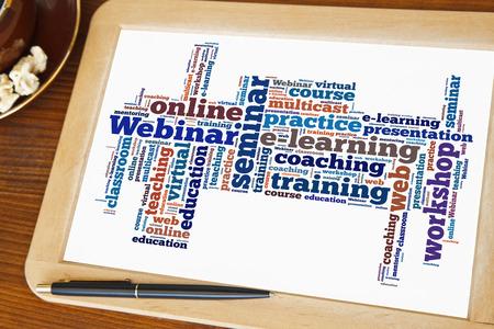 blackboard with webinar word cloud Stock Photo