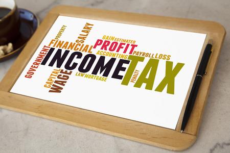 blackboard with tax word cloud photo