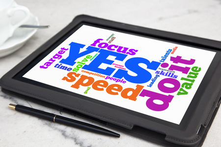 tablet with yes we can word cloud photo