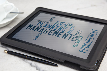 domestics: tablet with management word cloud
