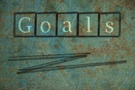reachable: goals writen on a wall background