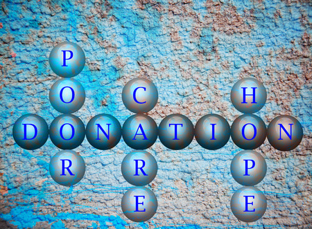 Donation writen on balls infront of a wall background photo