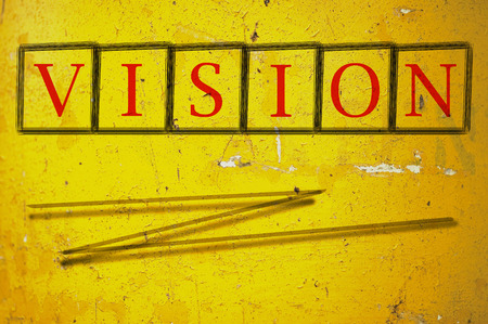 foresight: vision written on a wall background