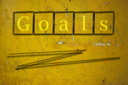 reachable: goals written on a wall background