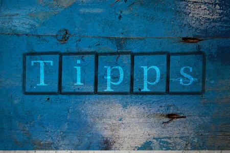 Hintergrund: Tipps auf eine Mauer geschrieben Stock Photo