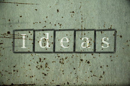 incidence: Ideas written on a wall background Stock Photo