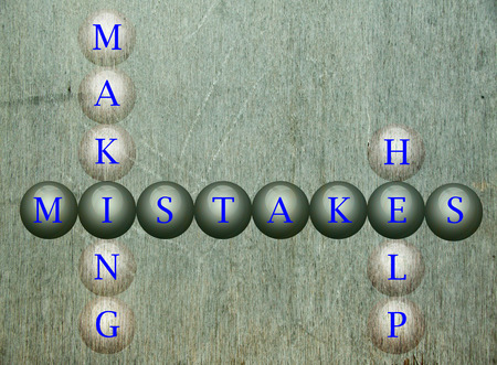 fallacy: Mistakes written on balls infront of a wall background