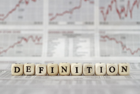 operational definition: Definition Word Built with letter cubes on newspaper background