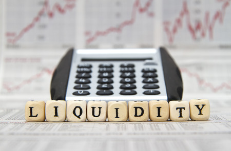 indebtedness: Liquidity word built with letter cubes