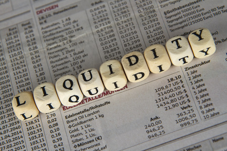 credit risk: Liquidity word built with letter cubes