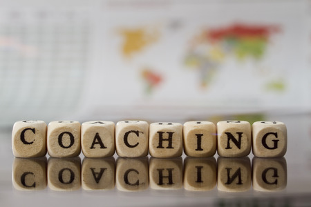 Coaching word built with letter cubes
