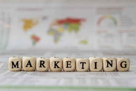 marketing: Marketing word built with letter cubes