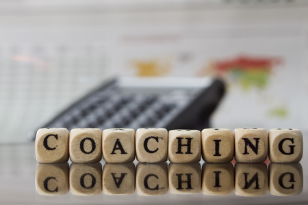 life coaching: Coaching word built with letter cubes