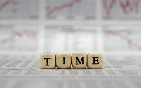 retrospective: Time word built with letter cubes Stock Photo