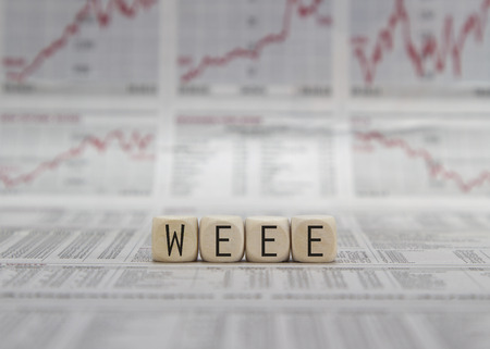 electrical materials: WEEE word built with letter cubes