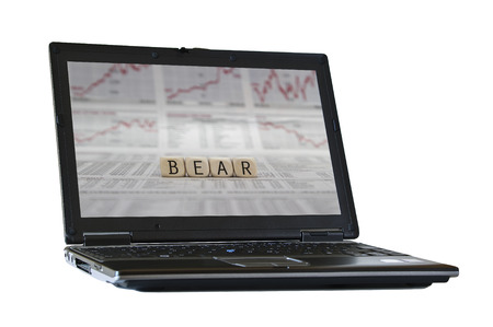 bear market: bear market on the screen of a isolated laptop Stock Photo