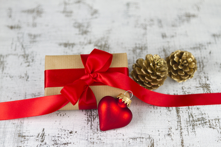gift wrapped: gift wrapped with a red bow