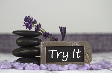 hot stones: try it with hot stones and lavender Stock Photo
