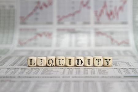 liquidity: Liquidity word on business newspaper Stock Photo