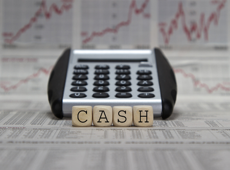 liquidity: Cash word on a business newspaper background