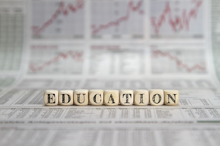 cost of education: Education word on a business newpaper