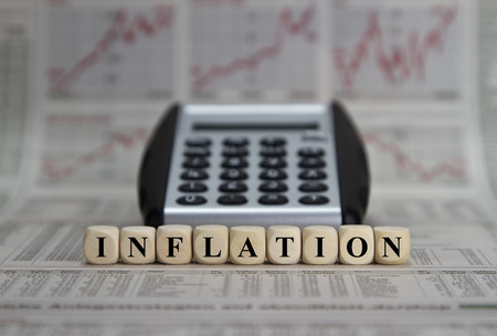 inflation basket: inflation word on a newspaper