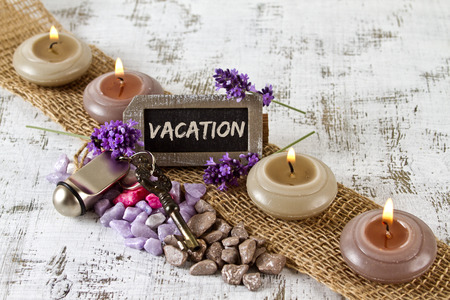 door key: vacation concept with lavender, candles and door key