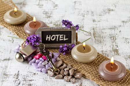door key: Hotel concept with door key and burning candles