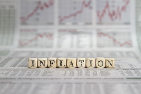 inflation word on a newspaper