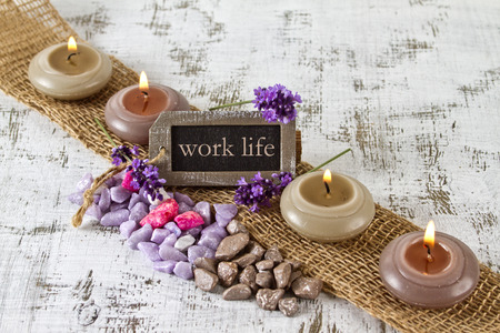 work life balance: work life balance concept with burning candles and lavender