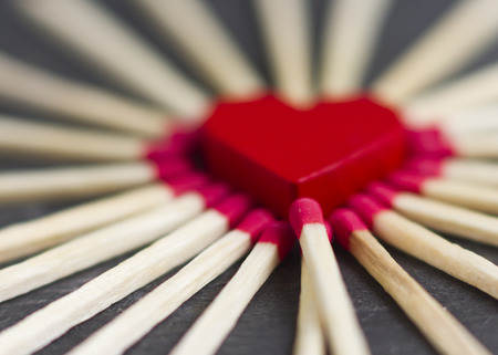 love declaration: red heart surrounded by matches