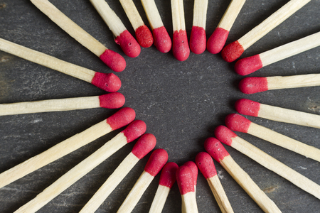 love declaration: Heart made with matches