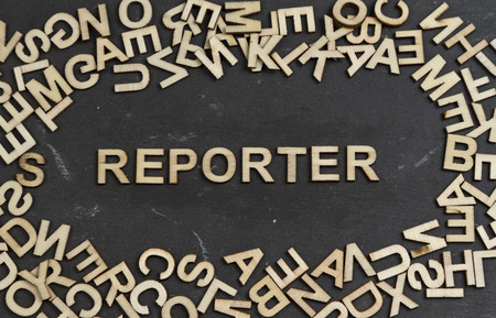 documenting: Reporter word built with wooden letters
