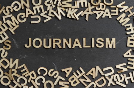 investigative: Journalism word built with wooden letters Stock Photo