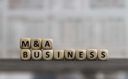 M&A Business word built with wooden letters Banco de Imagens