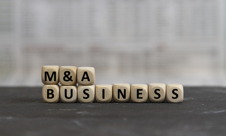 mergers: M&A Business word built with wooden letters Stock Photo