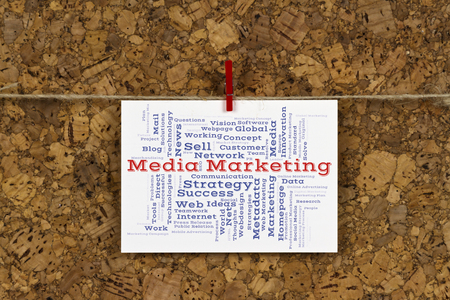 metadata: Media Marketing word cloud on business card pinned up on cork board Stock Photo