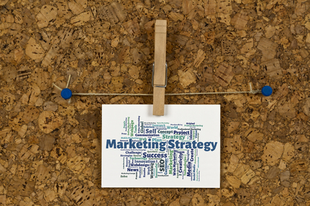 metadata: Marketing strategy word cloud on business card pinned up on cork board Stock Photo